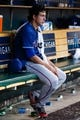 July 13, 2013; Detroit, MI, USA; Texas Rangers starting pitcher Derek Holland (45) sits in dugout during the fifth inning against the Detroit Tigers at Comerica Park. Mandatory Credit: Rick Osentoski-USA TODAY Sports