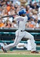 July 12, 2013; Detroit, MI, USA; Texas Rangers shortstop Elvis Andrus (1) hits a single fourth inning against the Detroit Tigers at Comerica Park. Mandatory Credit: Rick Osentoski-USA TODAY Sports