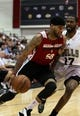 Jul 18, 2013; Las Vegas, NV, USA; Miami Heat guard D.J. Kennedy drives into Chicago Bulls guard Kyle Gibson while dribbling the ball during an NBA Summer League game at Cox Pavillion.  The Heat won the game 68-62. Mandatory Credit: Stephen R. Sylvanie-USA TODAY Sports