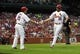 Jul 19, 2013; St. Louis, MO, USA; St. Louis Cardinals starting pitcher Jake Westbrook (35) is congratulated by first baseman Allen Craig (21) after scoring on a sacrifice fly by right fielder Carlos Beltran (not pictured) during the third inning against the San Diego Padres at Busch Stadium. Mandatory Credit: Jeff Curry-USA TODAY Sports