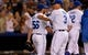 Jul 19, 2013; Kansas City, MO, USA; Kansas City Royals relief pitcher Greg Holland (56) is congratulated by manager Ned Yost (3) after the game against the Detroit Tigers at Kauffman Stadium. The Royals won 1-0. Mandatory Credit: Denny Medley-USA TODAY Sports