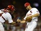 Jul 19, 2013; St. Louis, MO, USA; St. Louis Cardinals relief pitcher Edward Mujica (44) celebrates with catcher Yadier Molina (4) after defeating the San Diego Padres at Busch Stadium. St. Louis defeated San Diego 9-6. Mandatory Credit: Jeff Curry-USA TODAY Sports