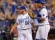 Jul 20, 2013; Kansas City, MO, USA; Kansas City Royals relief pitcher Greg Holland (56) is congratulated by catcher Salvador Perez (13) after the game against the Detroit Tigers at Kauffman Stadium. The Royals won 6-5. Mandatory Credit: Denny Medley-USA TODAY Sports