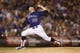 Jul 20, 2013; Denver, CO, USA; Colorado Rockies pitcher Josh Outman (88) delivers a pitch during the eighth inning against the Chicago Cubs at Coors Field. Mandatory Credit: Chris Humphreys-USA TODAY Sports
