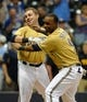 Jul 21, 2013; Milwaukee, WI, USA;  Milwaukee Brewers left fielder Caleb Gindl (left) and shortstop Jean Segura celebrates after Gindl's walkoff home run in the 13th inning against the Miami Marlins at Miller Park.  The Brewers beat the Marlins 1-0.  Mandatory Credit: Benny Sieu-USA TODAY Sports