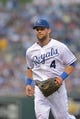 Jul 20, 2013; Kansas City, MO, USA; Kansas City Royals left fielder Alex Gordon (4) takes the field in between innings in the game against the Detroit Tigers at Kauffman Stadium. The Royals won 6-5. Mandatory Credit: Denny Medley-USA TODAY Sports