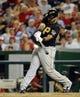 Jul 22, 2013; Washington, DC, USA; Pittsburgh Pirates first baseman Pedro Alvarez (24) singles during the eighth inning against the Washington Nationals at Nationals Park.  Mandatory Credit: Brad Mills-USA TODAY Sports