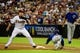 Jul 22, 2013; Phoenix, AZ, USA; Arizona Diamondbacks first baseman Paul Goldschmidt (44) catches the ball as Chicago Cubs shortstop Junior Lake (21) slides safely during the third inning at Chase Field. Mandatory Credit: Matt Kartozian-USA TODAY Sports