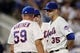 Jul 22, 2013; New York, NY, USA;  New York Mets pitching coach Dan Warthen (59) visits starting pitcher Dillon Gee (35) during the seventh inning against the Atlanta Braves at Citi Field.  Atlanta Braves won 2-1.  Credit: Anthony Gruppuso-USA TODAY Sports