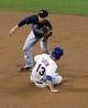 Jul 22, 2013; New York, NY, USA;  Atlanta Braves shortstop Andrelton Simmons (19) has New York Mets first baseman Josh Satin (13) out at second during the eighth inning at Citi Field.  Atlanta Braves won 2-1.  Credit: Anthony Gruppuso-USA TODAY Sports