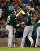 Jul 22, 2013; Houston, TX, USA; Oakland Athletics right fielder Josh Reddick (16) is congratulated by Brandon Moss (37) after hitting a home run during the eighth inning against the Houston Astros at Minute Maid Park. Mandatory Credit: Troy Taormina-USA TODAY Sports