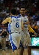 Jul 22, 2013; Las Vegas, NV, USA; Golden State Warriors guard Kent Bazemore congratulates Warriors guard Cameron Jones during the fourth quarter of the NBA Summer League Championship game against the Phoenix Suns at the Thomas and Mack Center. Golden State won the game 91-77 to remain undefeated during the Summer League games. Mandatory Credit: Stephen R. Sylvanie-USA TODAY Sports