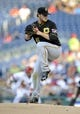 Jul 23, 2013; Washington, DC, USA; Pittsburgh Pirates starting pitcher Gerrit Cole (45) throws in the first inning against the Washington Nationals at Nationals Park. Mandatory Credit: Joy R. Absalon-USA TODAY Sports