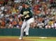 Jul 23, 2013; Houston, TX, USA; (Editors note: Caption correction) Oakland Athletics pitcher Jarrod Parker (11) delivers a pitch during the second inning against the Houston Astros at Minute Maid Park. Mandatory Credit: Troy Taormina-USA TODAY Sports