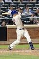 Jul 23, 2013; New York, NY, USA; New York Mets third baseman David Wright (5) singles to center during the sixth inning against the Atlanta Braves at Citi Field.  Mandatory Credit: Anthony Gruppuso-USA TODAY Sports
