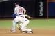 Jul 23, 2013; New York, NY, USA;  Atlanta Braves second baseman Dan Uggla (26) has New York Mets third baseman David Wright (5) out during the sixth inning at Citi Field.  Mandatory Credit: Anthony Gruppuso-USA TODAY Sports