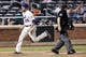 Jul 23, 2013; New York, NY, USA; New York Mets first baseman Ike Davis (29) crosses the plate to score during the sixth inning against the Atlanta Braves at Citi Field.  Mandatory Credit: Anthony Gruppuso-USA TODAY Sports