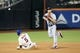 Jul 23, 2013; New York, NY, USA;  New York Mets third baseman David Wright (5) is out at second as Atlanta Braves shortstop Andrelton Simmons (19) completes the double play during the eighth inning at Citi Field.  Mandatory Credit: Anthony Gruppuso-USA TODAY Sports