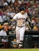 Jul 23, 2013; Houston, TX, USA; Houston Astros second baseman Jose Altuve (27) drives in a run with a sacrifice fly during the fifth inning against the Oakland Athletics at Minute Maid Park. Mandatory Credit: Troy Taormina-USA TODAY Sports
