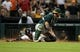 Jul 23, 2013; Houston, TX, USA; Houston Astros shortstop Jonathan Villar (back) slides safely for the winning run as Oakland Athletics catcher Derek Norris (36) fields the throw during the ninth inning at Minute Maid Park. Mandatory Credit: Troy Taormina-USA TODAY Sports