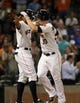 Jul 23, 2013; Houston, TX, USA; Houston Astros third baseman Matt Dominguez (30) is congratulated by Justin Maxwell (44) after hitting a home run during the ninth inning against the Oakland Athletics at Minute Maid Park. Mandatory Credit: Troy Taormina-USA TODAY Sports