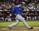Jul 24, 2013; Phoenix, AZ, USA;  Chicago Cubs first baseman Anthony Rizzo (44) hits an RBI double in the fourth inning during a baseball game against the Arizona Diamondbacks at Chase Field. Mandatory Credit: Rick Scuteri-USA TODAY Sports