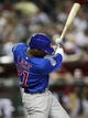 Jul 24, 2013; Phoenix, AZ, USA; Chicago Cubs center fielder Junior Lake (21) hits an RBI double in the fifth inning during a baseball game against the Arizona Diamondbacks at Chase Field. Mandatory Credit: Rick Scuteri-USA TODAY Sports