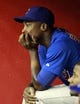 Jul 24, 2013; Phoenix, AZ, USA; Chicago Cubs left fielder Alfonso Soriano (12) sits in the dugout in the tenth inning during a baseball game against the Arizona Diamondbacks at Chase Field. Mandatory Credit: Rick Scuteri-USA TODAY Sports