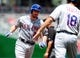Jul 26, 2013; Washington, DC, USA; New York Mets second baseman Daniel Murphy (left) is congratulated by third base coach Tim Teufel (right) after hitting a home run in the first inning against the Washington Nationals at Nationals Park. Mandatory Credit: Evan Habeeb-USA TODAY Sports