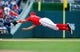Jul 26, 2013; Washington, DC, USA; Washington Nationals third baseman Ryan Zimmerman (11) dives for a ground ball during the game against the New York Mets at Nationals Park. Mandatory Credit: Evan Habeeb-USA TODAY Sports