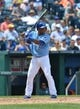 July 21, 2013; Kansas City, MO, USA;  Kansas City Royals second basemen Miguel Tejada (24) at bat against the Detroit Tigers during the fifth inning at Kauffman Stadium.  Mandatory Credit: Peter G. Aiken-USA TODAY Sports