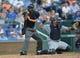 July 21, 2013; Kansas City, MO, USA; Home plate umpire Vic Carapazza (left) calls a strike during a game between Detroit Tigers and the Kansas City Royals at Kauffman Stadium.  Mandatory Credit: Peter G. Aiken-USA TODAY Sports