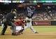 Jul 28, 2013; Phoenix, AZ, USA; San Diego Padres outfielder Carlos Quentin (18) hits an RBI single against the Arizona Diamondbacks in the first inning at Chase Field. Mandatory Credit: Jennifer Stewart-USA TODAY Sports