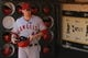 Jul 28, 2013; Oakland, CA, USA; Los Angeles Angels infielder Mark Trumbo (44) holds onto a helmet before the start of the game against the Oakland Athletics at O.co Coliseum. The Athletics defeated the Angels 10-6. Mandatory Credit: Cary Edmondson-USA TODAY Sports