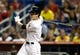 Jul 27, 2013; Miami, FL, USA;  Miami Marlins left fielder Christian Yelich hits a single against the Pittsburgh Pirates in the first inning at Marlins Park. Mandatory Credit: Robert Mayer-USA TODAY Sports