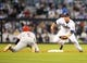 Jul 30, 2013; San Diego, CA, USA; Cincinnati Reds shortstop Zack Cozart (2) is tagged out by San Diego Padres second baseman Jedd Gyorko (9) trying to dive back to second base during the second inning at Petco Park. Mandatory Credit: Christopher Hanewinckel-USA TODAY Sports