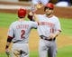 Jul 30, 2013; San Diego, CA, USA; Cincinnati Reds first baseman Joey Votto (19) is congratulated by shortstop Zack Cozart (2) after scoring in the sixth inning against the San Diego Padres at Petco Park. Mandatory Credit: Christopher Hanewinckel-USA TODAY Sports