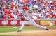 Jul 30, 2013; Arlington, TX, USA; Los Angeles Angels starting pitcher C.J. Wilson (33) throws during the game against the Texas Rangers at Rangers Ballpark in Arlington. Texas won 14-11.  Mandatory Credit: Kevin Jairaj-USA TODAY Sports