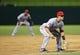 Jul 30, 2013; Arlington, TX, USA; Los Angeles Angels shortstop Tommy Field (12) and shortstop Erick Aybar (back) play defense during the game against the Texas Rangers at Rangers Ballpark in Arlington. Texas won 14-11.  Mandatory Credit: Kevin Jairaj-USA TODAY Sports