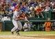 Jul 30, 2013; Arlington, TX, USA; Los Angeles Angels center fielder Mike Trout (27) bats during the game against the Texas Rangers at Rangers Ballpark in Arlington. Texas won 14-11.  Mandatory Credit: Kevin Jairaj-USA TODAY Sports