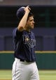 Jul 11, 2013; St. Petersburg, FL, USA; Tampa Bay Rays starting pitcher Matt Moore (55) raises his hat to the crowd against the Minnesota Twins at Tropicana Field. Tampa Bay Rays defeated the Minnesota Twins 4-3. Mandatory Credit: Kim Klement-USA TODAY Sports