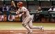 Jul 30, 2013; St. Petersburg, FL, USA; Arizona Diamondbacks third baseman Martin Prado (14) at bat against the Tampa Bay Rays at Tropicana Field. Mandatory Credit: Kim Klement-USA TODAY Sports