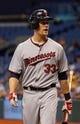 Jul 10, 2013; St. Petersburg, FL, USA; Minnesota Twins first baseman Justin Morneau (33) reacts after at bat against the Tampa Bay Rays at Tropicana Field. Mandatory Credit: Kim Klement-USA TODAY Sports