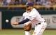 Jul 30, 2013; St. Petersburg, FL, USA; Tampa Bay Rays first baseman James Loney (21) throws the ball to first against the Arizona Diamondbacks at Tropicana Field. Mandatory Credit: Kim Klement-USA TODAY Sports