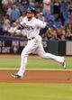 Jul 30, 2013; St. Petersburg, FL, USA; Tampa Bay Rays first baseman James Loney (21) runs against the Arizona Diamondbacks at Tropicana Field. Mandatory Credit: Kim Klement-USA TODAY Sports