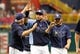 Jul 11, 2013; St. Petersburg, FL, USA; Tampa Bay Rays manager Joe Maddon (70) high fives catcher Jose Molina (28) and relief pitcher Alex Torres (54) after they beat the Minnesota Twins at Tropicana Field. Tampa Bay Rays defeated the Minnesota Twins 4-3. Mandatory Credit: Kim Klement-USA TODAY Sports