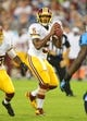 Aug 8, 2013; Nashville, TN, USA; Washington Redskins quarterback Pat White (5) drops back into the pocket to pass against the Tennessee Titans during the second half at LP Field. The Redskins beat the Titans 22-21. Mandatory Credit: Don McPeak-USA TODAY Sports
