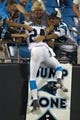 Aug 9, 2013; Charlotte, NC, USA; Carolina Panthers cornerback Josh Norman (24) jumps up in the stands to celebrate after returning an interception for a touchdown during the second half against the Chicago Bears. The Panthers defeated the Bears 24-17. Mandatory Credit: Jeremy Brevard-USA TODAY Sports