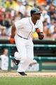 Jul 31, 2013; Detroit, MI, USA; Detroit Tigers right fielder Torii Hunter (48) hits an RBI single fourth inning against the Washington Nationals at Comerica Park. Mandatory Credit: Rick Osentoski-USA TODAY Sports