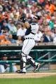Jul 31, 2013; Detroit, MI, USA; Detroit Tigers catcher Alex Avila (13) makes a catch against the Washington Nationals at Comerica Park. Mandatory Credit: Rick Osentoski-USA TODAY Sports